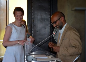 Prof. Nehal Bhuta awards a course certificate to AEL participant Anna Hall