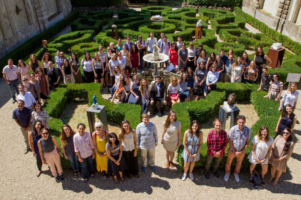Photo from above, a group of young people in a Italian garden