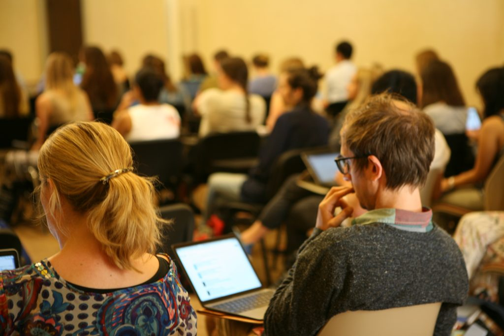 Students on laptops in seminar
